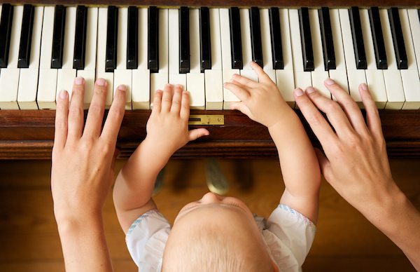 baby learning how to play piano